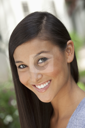 Attractive Young Asian Woman stock photo, Portrait of a beautiful Asian woman smiling into the camera in an outdoor setting. Vertical shot. by Edward Bock