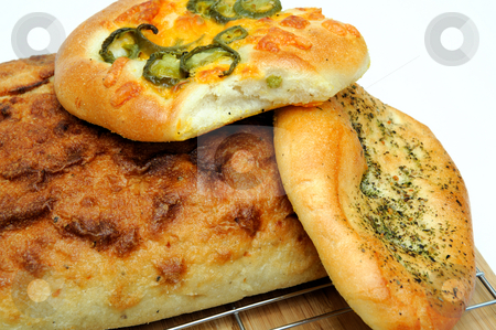 Bread And Rolls stock photo, A square loaf of artisan bread and Focaccia rolls in cluding Italian herb and Jalapeno cheddar cheese by Lynn Bendickson
