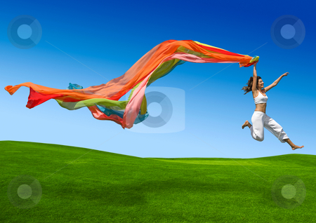Rainbow woman stock photo, Young beautiful woman jumping with a scarf by ikostudio