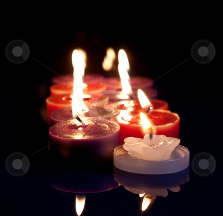 Red, white, purple candles stock photo, Some red, white and purple candles lined up by Stephen Clarke
