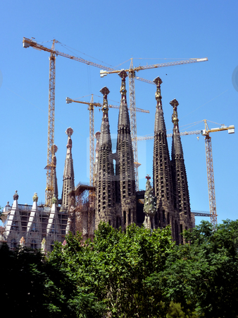Sagrada familia church in Barcelona, Spain stock photo, View of the back of the Sagrada familia church in Barcelona, Spain, with its towers and the cranes arround, by beautiful weather by Elenaphotos21