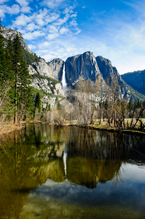 Yosemite National Park stock photo, Water fall at Yosemite National Park reflecting in the Merced river. by Don Fink