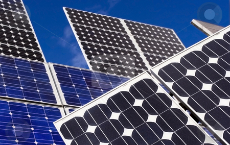 Power stock photo, Solar panels and blue sky by Charles Taylor