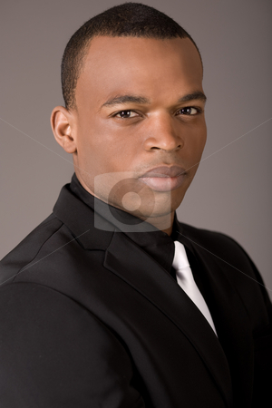 Closeup of young black american stock photo, Closeup of young black american on a grey background by Get4net