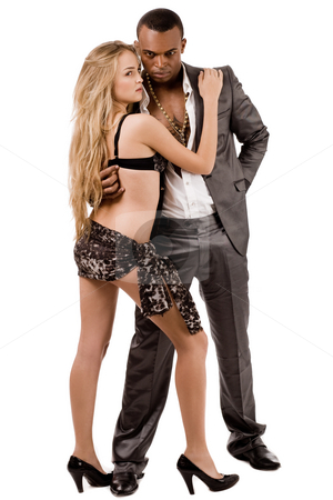 Woman in bikini and a business man posing stock photo, Woman in bikini and a business man posing indoor studio by Get4net