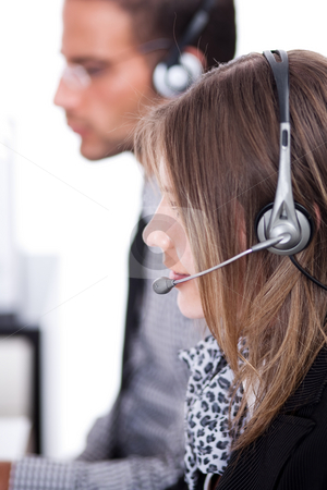 Customer executives with headphone stock photo, Customer executives doing their operations with headphone by Get4net