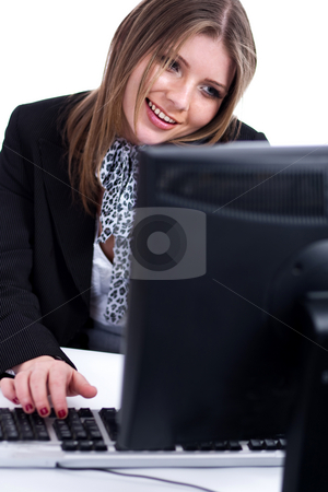 Smiling professional working with desktop at his desk stock photo, Smiling professional  working with desktop at his desk over white background by Get4net
