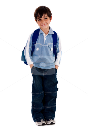 Young school boy smiling and looking away stock photo, Young school boy standing on white isolated background by Get4net