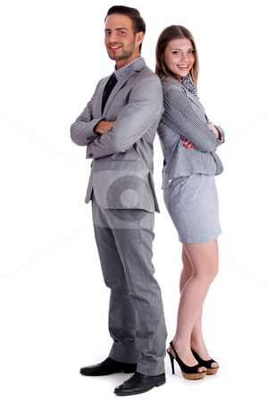 Young business collegues standing back to back stock photo, Young business collegues standing back to back wearing business suit with holding hands over white background by Get4net