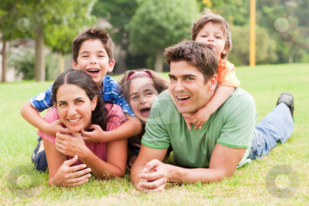 Family lifestyle portrait stock photo, Family lifestyle portrait of a mum and dad having fun with their kids by Get4net