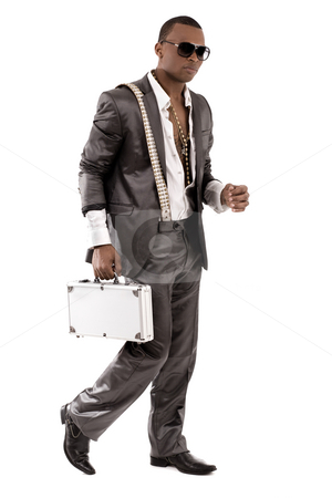 Gangster walking with his briefcase stock photo, Gangster walking with his briefcase on a isolated white background by Get4net