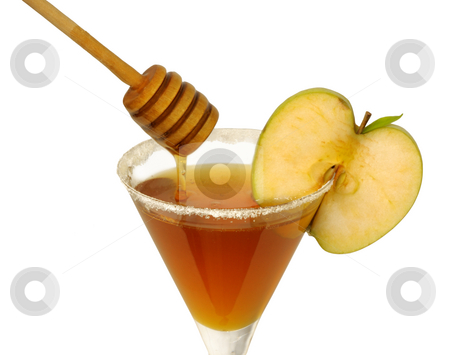 Rosh Hashana honey cocktail stock photo, Honey in a cocktail glass with apple and sugar on the rim and a wooden drizzler pouring honey. (Apple and honey is a tradional food on the Jewish new year) by Boaz Yiftach