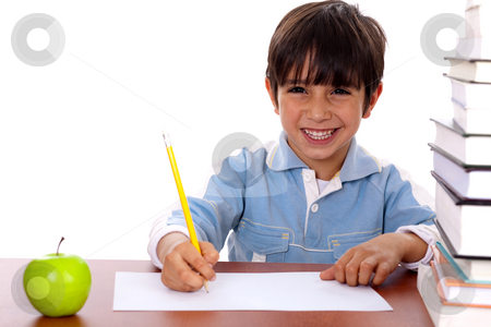 Young kid enjoying art stock photo, Young kid enjoying art as he draws on blank sheet of paper by Get4net