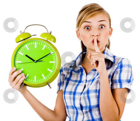 Girl with the clock asking us to maintain silence stock photo, Girl with the clock asking us to maintain silence on a white background by Get4net 