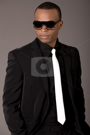 Handsome black man in business suit stock photo, Handsome black man in business suit, indoor studio by Get4net