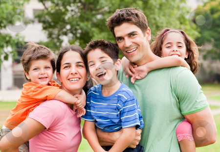 Piggyride time, kids enjoying stock photo, Caucasian parents piggyback their children, posing outdoors by Get4net