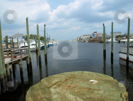 Boat slip stock photo, Boat slip at the ocean waiting for the ship to come home. by Tim Markley