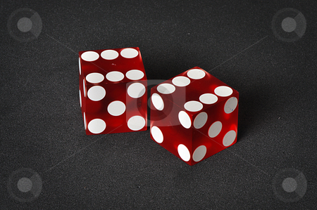 Casino dice stock photo, Red and white casino dice on a unique black background by Boaz Yiftach
