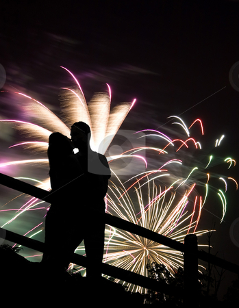 Fireworks Kiss stock photo, A silhouette of a kissing couple in front of a huge fireworks display. by Todd Arena