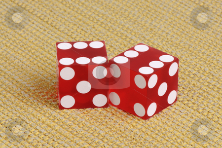 Casino dice on a golden fabric stock photo, Authentic casino dice on a golden striped fabric. by Boaz Yiftach