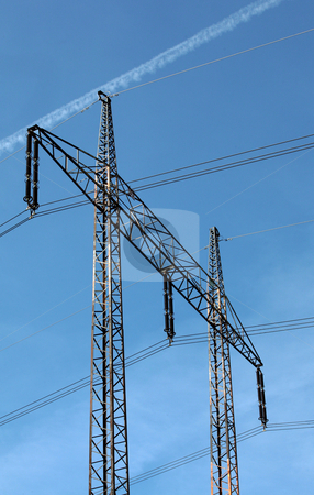 Electricity pylons stock photo, Electricity pylons and cables on the bright blue sky by Tomas Hajek