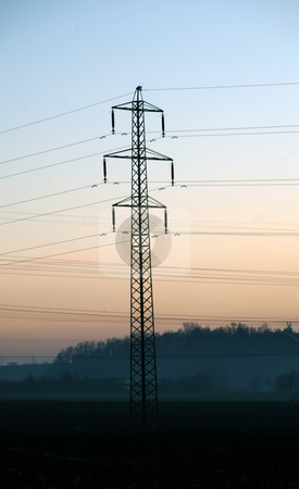 Electric pylon stock photo, Landscaoe with silhouette of electric pylon during sunset by Tomas Hajek