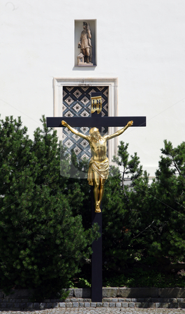 Crucifix in church Vranov stock photo, Crucifix in front of the church in Vranov near Brno, Czech republic by Tomas Hajek