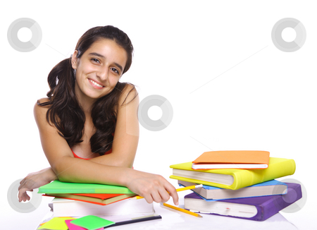 Young girl sitting in front of her books stock photo, Young girl sitting in front of her books and smiling by Gevorg Gevorgyan
