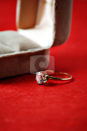 Diamond ring stock photo, Diamond engagement ring on red background by HD Connelly