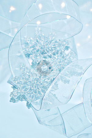 Snowflakes stock photo, Christmas still life with snowflakes and ribbon by HD Connelly
