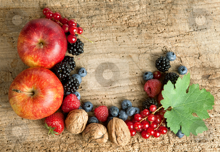 Thankgiving board with fruit stock photo, Thanksgiving border made of autumn fruits on a wooden board by Anneke