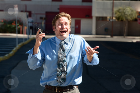 Good-looking guy frustrated with cell phone. stock photo, Exasperated business man gives up. by Scott Griessel