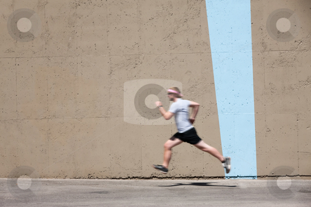 Man runs to prepare for race stock photo, Man runs for fun and exercise by Scott Griessel