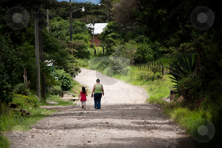 Woman and child walking in Costa Rica stock photo, Woman and child walking in scenic Costa Rica by Scott Griessel