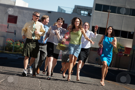 Business people running stock photo, Happy group of business people running on city street by Scott Griessel