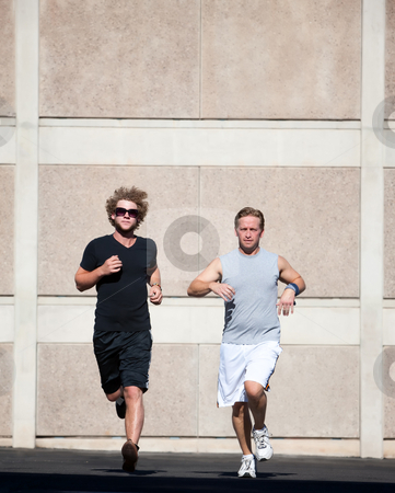 Handsome men running for exercise. stock photo, Two male friends practice for race by Scott Griessel