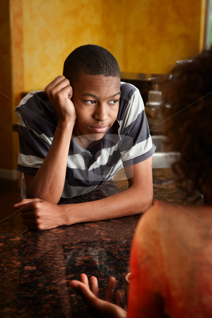 African-American young man and woman talking in kitchen stock photo, Upset African-American young man and woman talking in kitchen by Scott Griessel