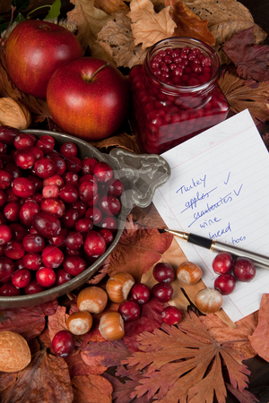 Shopping for thanksgiving day stock photo, Shopping list with thanksgiving ingredients, cranberries and apples by Anneke