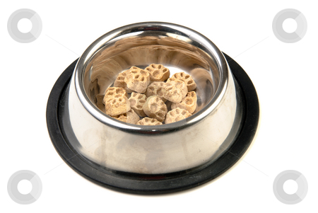Dog Food stock photo, Some dog food in the shape of paws in a metal bowl, isolated against a white background. by Richard Nelson