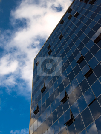 Modern skyscraper on blue sky stock photo,  by Nikola Nikolovski