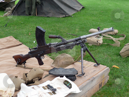 World war two machine gun side view stock photo, British world war two machine gun with army tent by Michael Travers