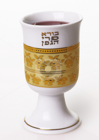 Wine cup with the Hebrew blessing on wine stock photo, A decorated wine cup with the hebrew blessing on wine on friday evenings. by Boaz Yiftach