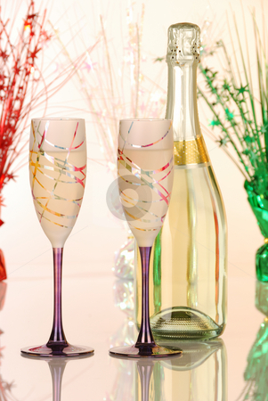 Festive glasses of champagne stock photo, Festive glasses of champagne with decorations by Hector Arencibia