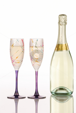 Champagne bottle with two festive glasses stock photo, Champagne bottle with two festive glasses with white background by Hector Arencibia