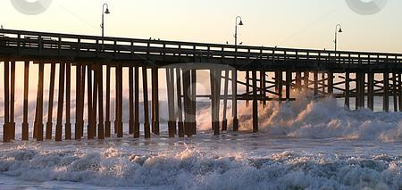 Ocean Wave Storm Pier stock photo, Ocean waves throughout at storm crashing into a wooden pier. by Henrik Lehnerer