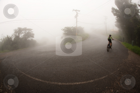 Bicyclist in the Costa Rican cloud forest stock photo, Bicyclist in the Costa Rican cloud forest near Monteverde by Scott Griessel
