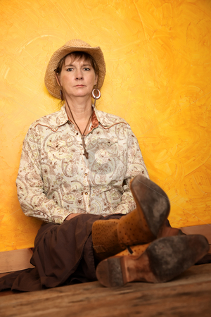 Pretty Western Woman  stock photo, Pretty western woman in cowboy shirt and hat by Scott Griessel