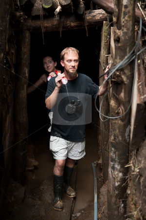 Couple exploring abandoned gold mine in Costa Rica stock photo, Couple exploring rustic abandoned gold mine in Costa Rica by Scott Griessel