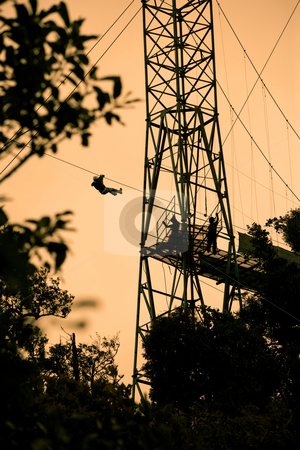 Tourists on zip line in Costa Rica stock photo, Silhoutte of tourists on zip line in Costa Rica by Scott Griessel