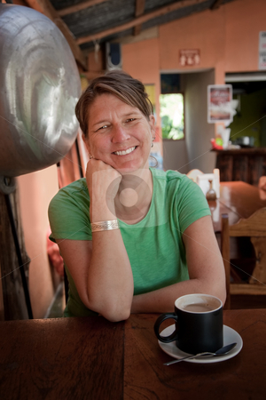 Woman in a Costa Rican cafe stock photo, Pretty adult woman in a Costa Rican cafe by Scott Griessel